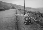 SD970733A, Man marking Ordnance Survey minor control revision point with an arrow in 1950s