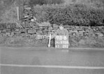 SD970672B, Man marking Ordnance Survey minor control revision point with an arrow in 1950s