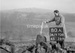 SD970880A, Man marking Ordnance Survey minor control revision point with an arrow in 1950s