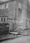 SD970801B, Man marking Ordnance Survey minor control revision point with an arrow in 1950s