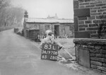 SD970883L, Man marking Ordnance Survey minor control revision point with an arrow in 1950s