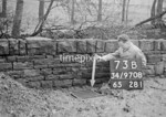 SD970873B, Man marking Ordnance Survey minor control revision point with an arrow in 1950s