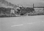 SD970697B, Man marking Ordnance Survey minor control revision point with an arrow in 1950s