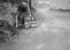 SD970679B, Man marking Ordnance Survey minor control revision point with an arrow in 1950s