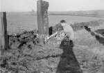 SD970554A2, Man marking Ordnance Survey minor control revision point with an arrow in 1950s
