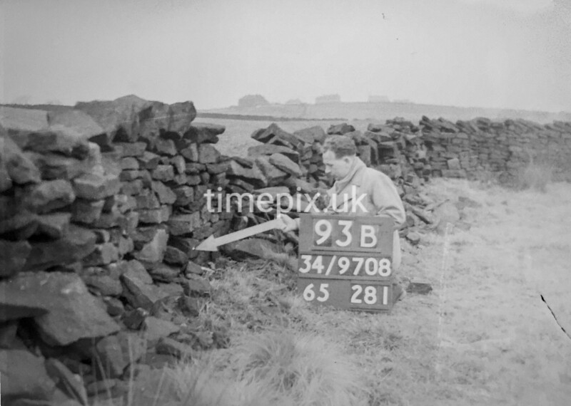 SD970893B, Man marking Ordnance Survey minor control revision point with an arrow in 1950s