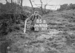 SD970785B, Man marking Ordnance Survey minor control revision point with an arrow in 1950s
