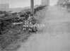 SD970633A, Man marking Ordnance Survey minor control revision point with an arrow in 1950s