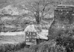SD970871A, Man marking Ordnance Survey minor control revision point with an arrow in 1950s