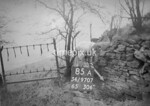 SD970785A, Man marking Ordnance Survey minor control revision point with an arrow in 1950s