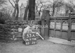 SD970853A, Man marking Ordnance Survey minor control revision point with an arrow in 1950s