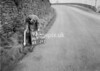 SD970693L, Man marking Ordnance Survey minor control revision point with an arrow in 1950s