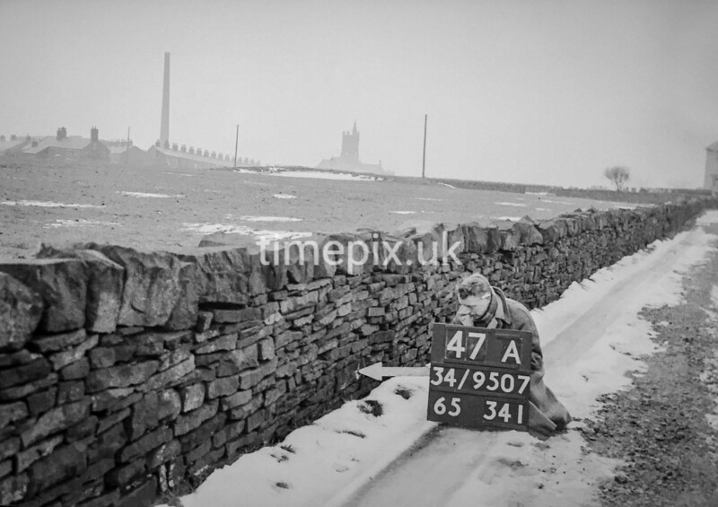 SD950747A, Man marking Ordnance Survey minor control revision point with an arrow in 1950s