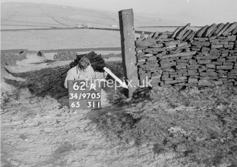 SD970562A1, Man marking Ordnance Survey minor control revision point with an arrow in 1950s