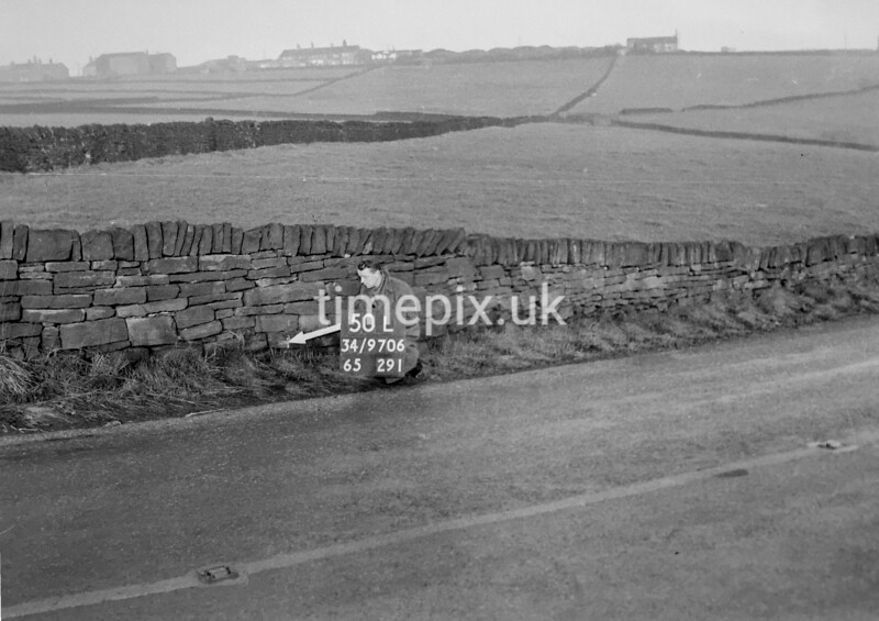 SD970650L, Man marking Ordnance Survey minor control revision point with an arrow in 1950s