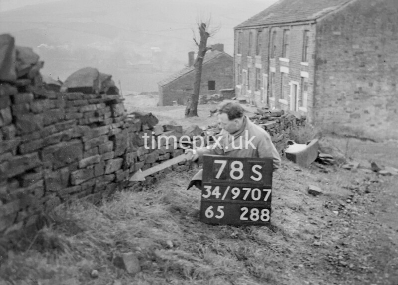 SD970778S, Man marking Ordnance Survey minor control revision point with an arrow in 1950s