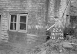 SD970822A, Man marking Ordnance Survey minor control revision point with an arrow in 1950s