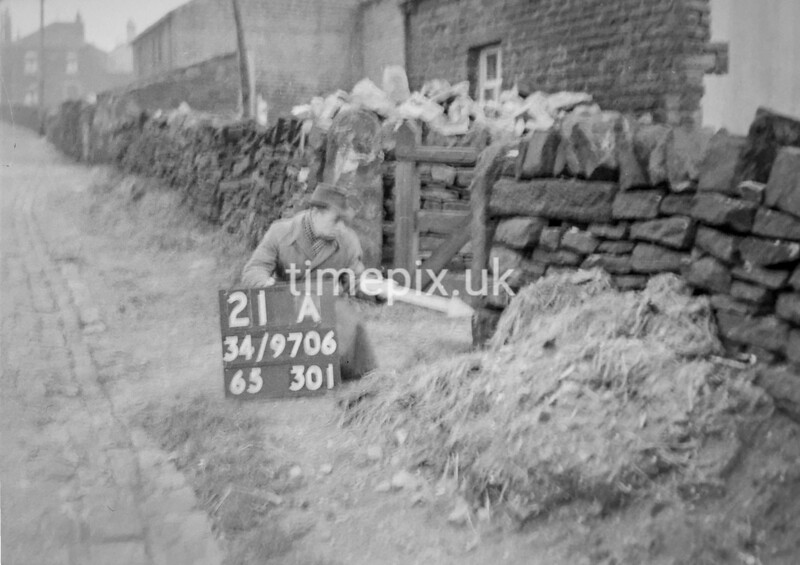 SD970621A, Man marking Ordnance Survey minor control revision point with an arrow in 1950s