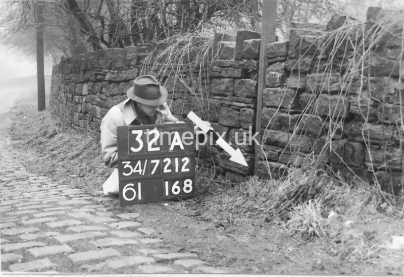 SD721232A, Man marking Ordnance Survey minor control revision point with an arrow in 1940s