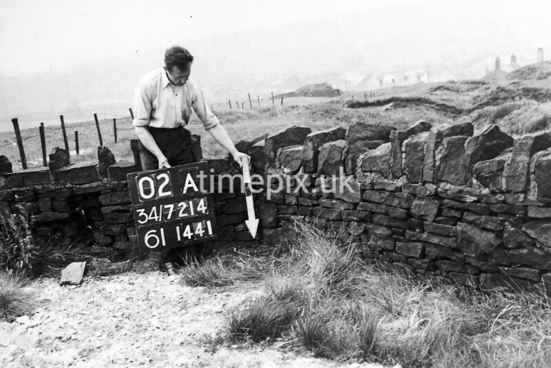SD721402A, Man marking Ordnance Survey minor control revision point with an arrow in 1950s