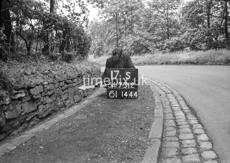 SD731217S, Man marking Ordnance Survey minor control revision point with an arrow in 1950s