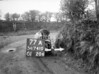 SD741077A, Man marking Ordnance Survey minor control revision point with an arrow in 1940s