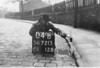 SD721304B, Man marking Ordnance Survey minor control revision point with an arrow in 1940s