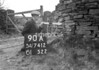 SD741290A, Man marking Ordnance Survey minor control revision point with an arrow in 1950s