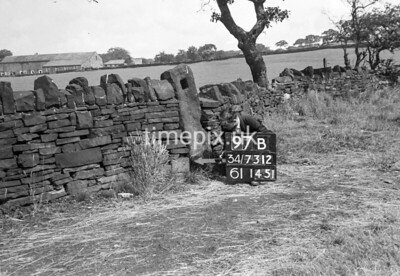 SD731297B, Man marking Ordnance Survey minor control revision point with an arrow in 1950s