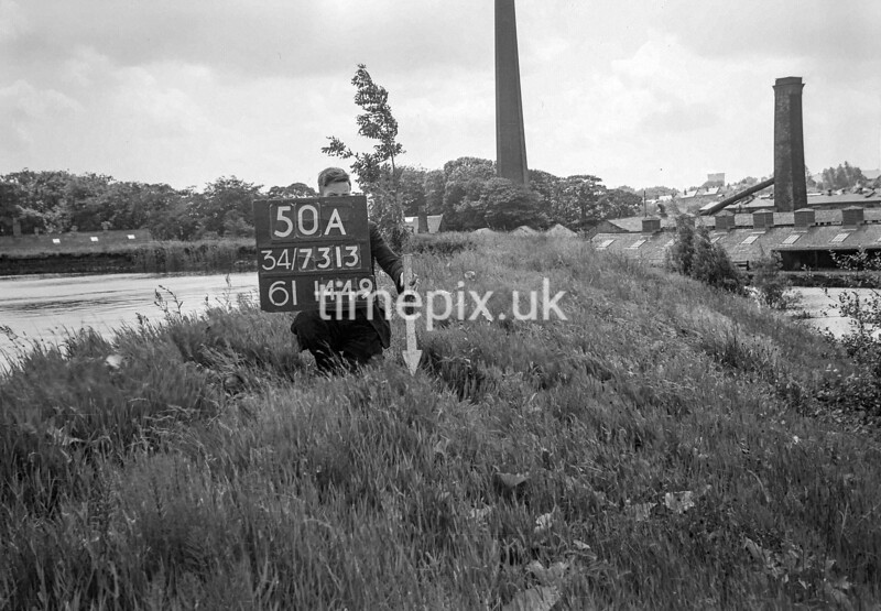 SD731350A, Man marking Ordnance Survey minor control revision point with an arrow in 1950s