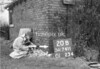 SD741120B, Man marking Ordnance Survey minor control revision point with an arrow in 1940s