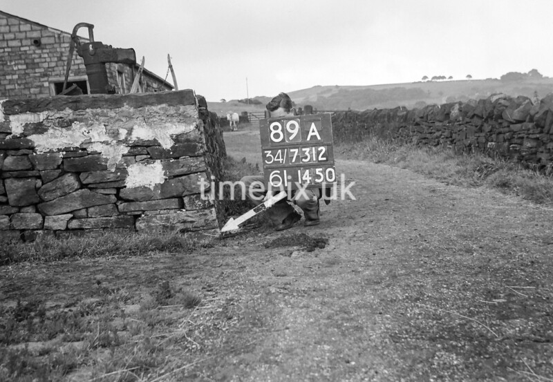 SD731289A2, Man marking Ordnance Survey minor control revision point with an arrow in 1950s