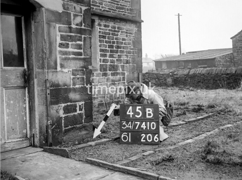 SD741045B, Man marking Ordnance Survey minor control revision point with an arrow in 1940s
