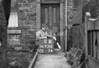 SD731211A, Man marking Ordnance Survey minor control revision point with an arrow in 1940s
