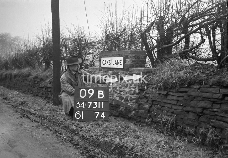 SD731109B, Man marking Ordnance Survey minor control revision point with an arrow in 1940s