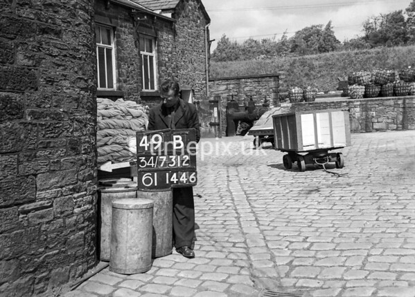 SD731249B, Man marking Ordnance Survey minor control revision point with an arrow in 1950s