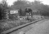 SD731226A, Man marking Ordnance Survey minor control revision point with an arrow in 1940s