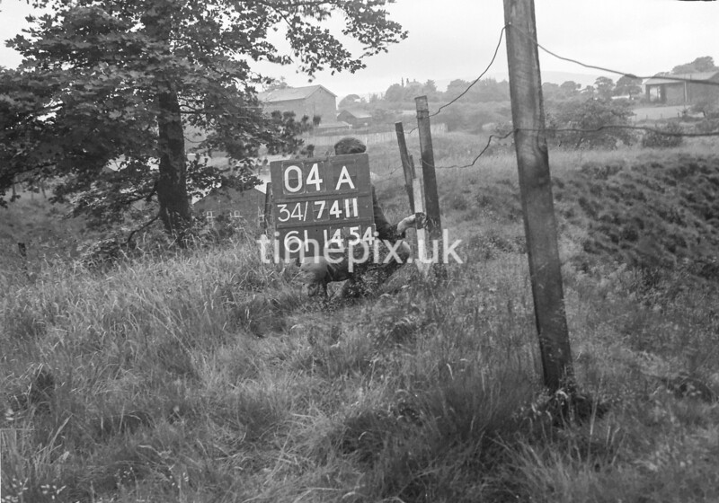 SD741104A, Man marking Ordnance Survey minor control revision point with an arrow in 1950s