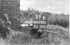 SD721237B, Man marking Ordnance Survey minor control revision point with an arrow in 1940s