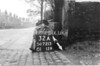 SD721332A, Man marking Ordnance Survey minor control revision point with an arrow in 1940s