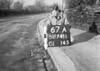 SD741167A, Man marking Ordnance Survey minor control revision point with an arrow in 1940s