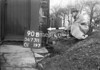 SD731190B, Man marking Ordnance Survey minor control revision point with an arrow in 1940s