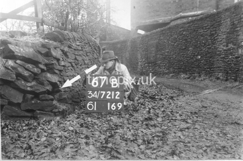 SD721267B, Man marking Ordnance Survey minor control revision point with an arrow in 1940s