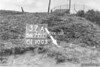 SD721237A, Man marking Ordnance Survey minor control revision point with an arrow in 1940s