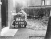 SD721186L, Man marking Ordnance Survey minor control revision point with an arrow in 1940s