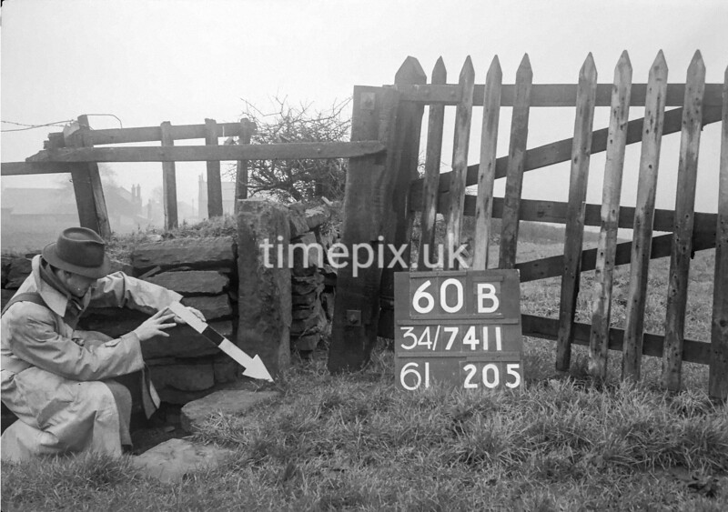SD741160B, Man marking Ordnance Survey minor control revision point with an arrow in 1940s