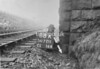SD721188A, Man marking Ordnance Survey minor control revision point with an arrow in 1940s