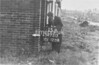 SD721315B, Man marking Ordnance Survey minor control revision point with an arrow in 1940s