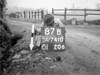 SD741087B, Man marking Ordnance Survey minor control revision point with an arrow in 1940s