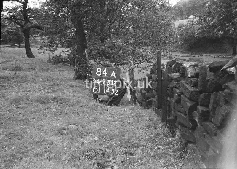 SD731284A, Man marking Ordnance Survey minor control revision point with an arrow in 1950s